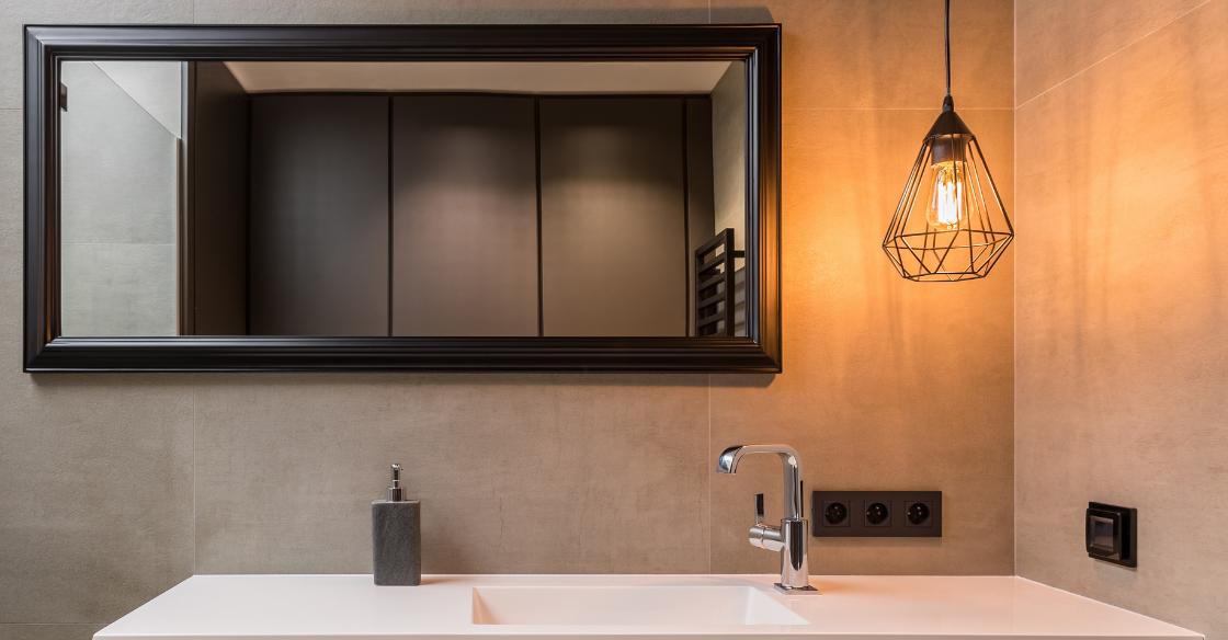 Pendant light hung over a bathroom sink