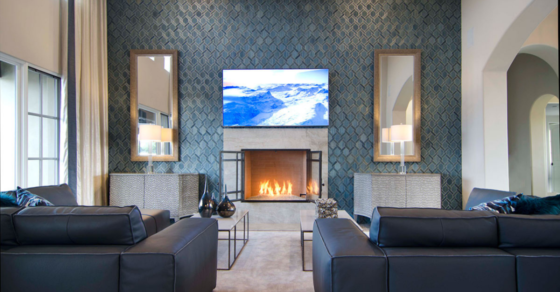 Living room with blue tilled wall