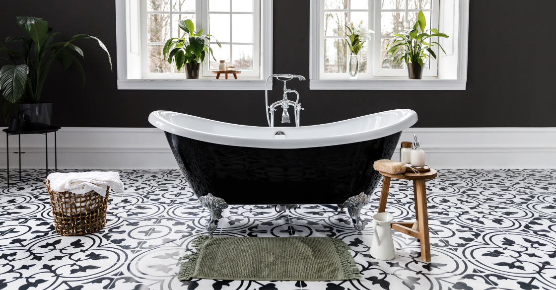 Bathroom with a black statement wall