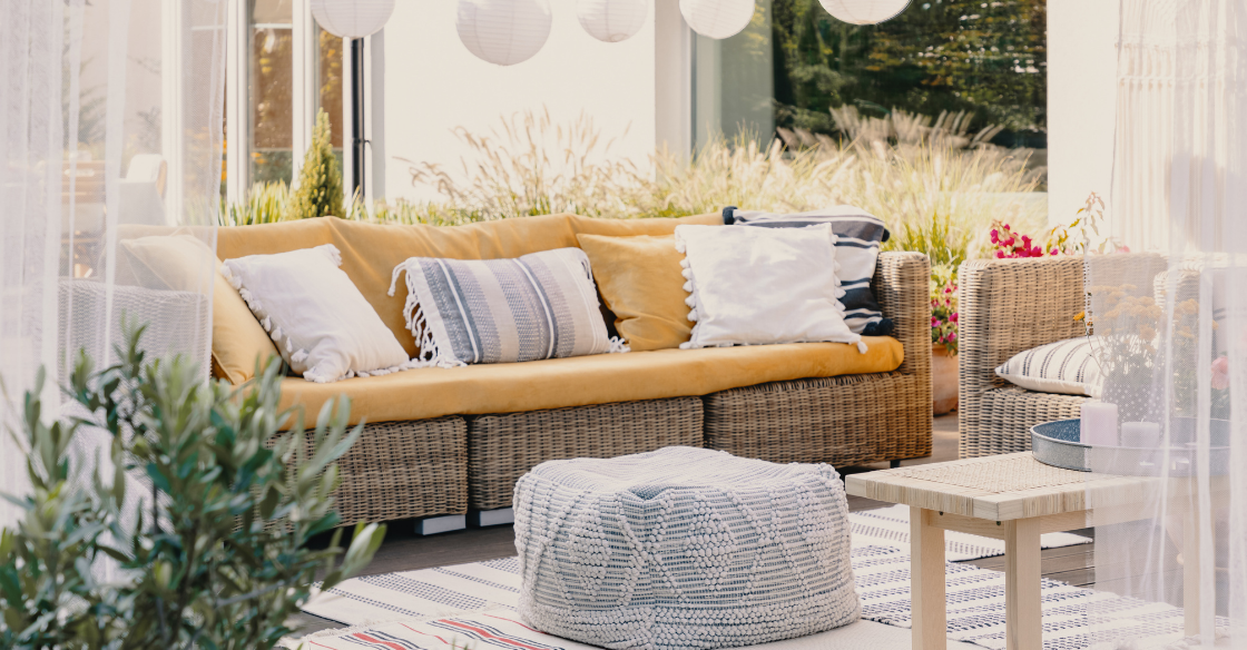 Outdoors space decorated with lights and cozy furniture