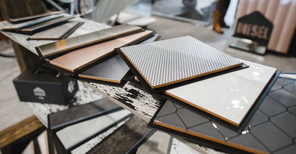 Tile material options laid out on a table