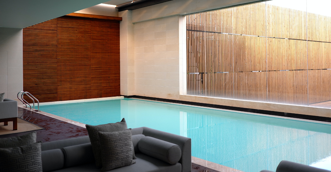 Hotel swimming pool with floor to ceiling windows