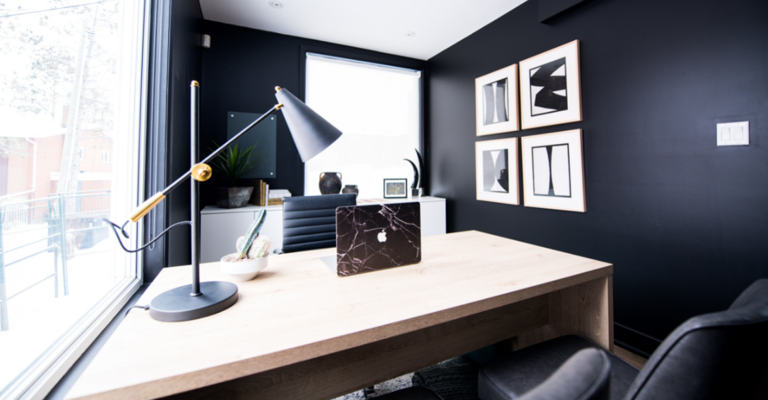 Minimalist home office with black walls